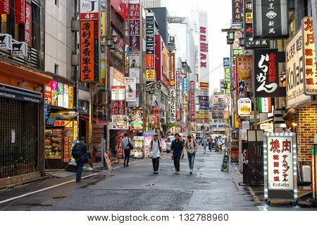 TOKYO JAPAN - May 17 2016: Kabukicho is Japan's largest red light district features bars nightclubs pachinko parlors love hotels. The area is a nightlife district known as Sleepless Town.