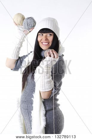 Positive pregnant woman in woollen clothes studio photo