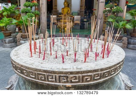 BANGKOK THAILAND -7 MAY 2016 : Incense burner and Golden buddha statue in Wat Kalayanamitr Bangkok, Thailand