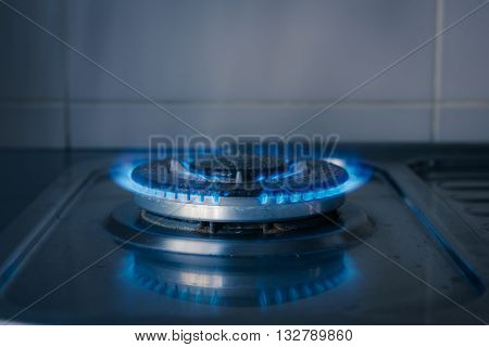 blue gas burning from old kitchen gas stove