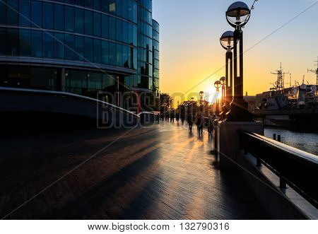 Sunset Forms Silhouette Of Thames Sidewalk