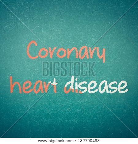 Green blackboard with hand written words note Coronary Heart Disease process in vintage style