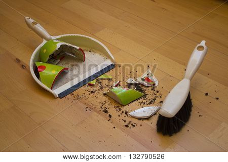 Brooming broken flower pot with small brush