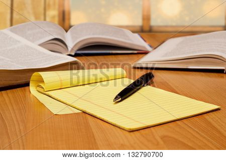 yellow legal pad with pen on the table