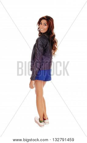 A pretty woman in a full lights image looking over her shoulder with long brunette hair isolated for white background.