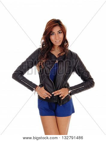A beautiful young woman in blue shorts wearing a black leather jacket standing isolated for white background.