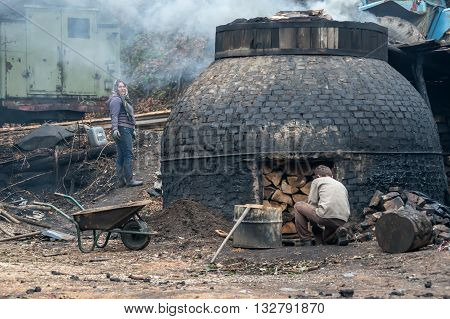 Klokocevac Serbia - March 24 2016: The production of charcoal in a traditional manner in the forest using beech wood