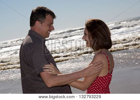 Romance On Vacation: Couple In Love Looking At Each Other