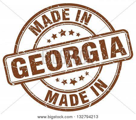 made in Georgia brown round vintage stamp.Georgia stamp.Georgia seal.Georgia tag.Georgia.Georgia sign.Georgia.Georgia label.stamp.made.in.made in.