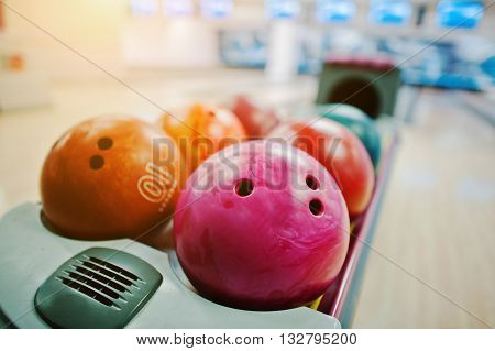 A Group Of Colored Bowling Balls At Bowl Lift