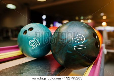 Two Colored Bowling Balls Of Number 16 And 15
