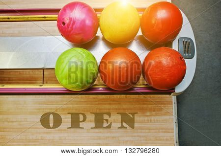 The word open background bowling balls at alley