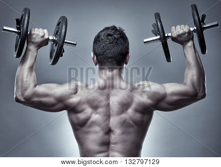 Man Doing Shoulder Workout In Studio