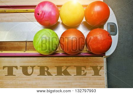 The word turkey background bowling balls at alley