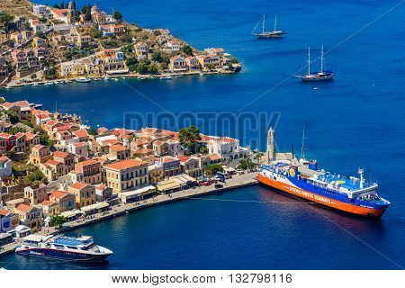 Symi island, Greece - May 18, 2016: the scenic waterfront with colourful houses of Symi in May 18, 2016, Symi island, Dodecanese, Greece.