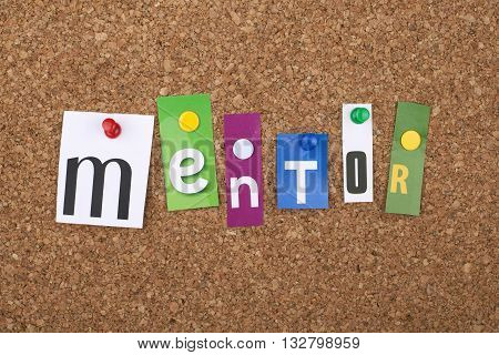 Mentor word as letters pinned on cork board
