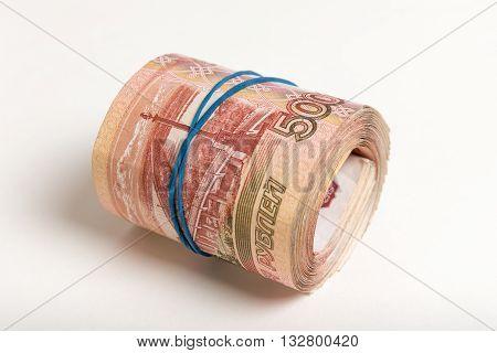 banknote bundle folded into a tube closeup