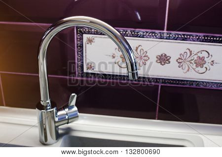 Kitchen Mixer Tap Into Granite Work Surface Background Violet Tile With Ornament