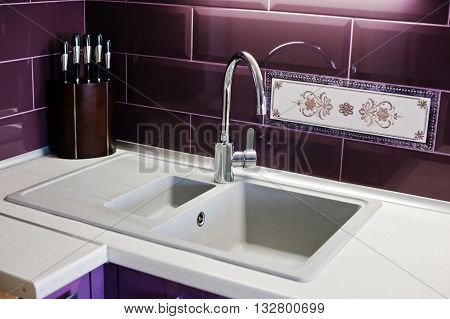 Kitchen Mixer Tap Into Granite Work Surface Background Violet Tile And Knifes