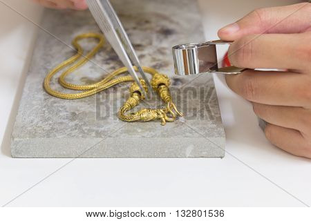 Gold necklace hand craft on stone gold necklace gold bar gold goldsmith.
