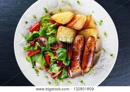 Roasted Sausages with Chips and Mix Vegetable salad.
