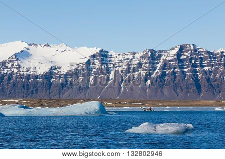 Jakulsalon lagoon with mountain snow covered  background, Iceland, natural landscape background