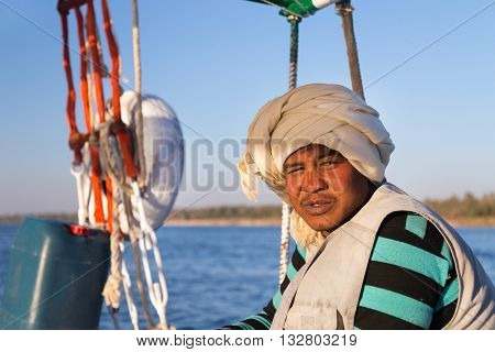 EGYPT -  FEBRUARY 9, 2016: Portrait of Nubian felucca sailing crew man on trip on the Nile.