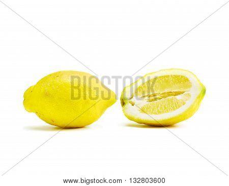 Close up of raw untreated genuine big Lemon isolated on white