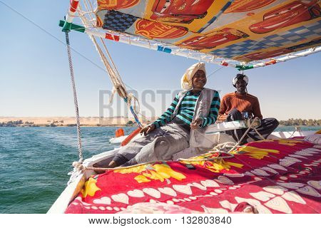 NILE, EGYPT - FEBRUARY 8, 2016: Nubian felucca sailing crew on trip on the Nile.