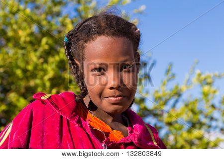 ASWAN, EGYPT - FEBRUARY 7, 2016: Portrait of Nubian girl.