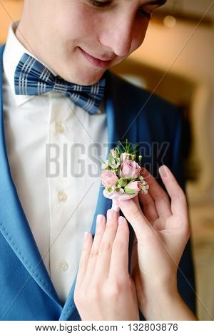 Groom And Bride Are Wearing A Boutonniere Indoors. Male Portrait Of Handsome Guy. Beautiful Model Bo