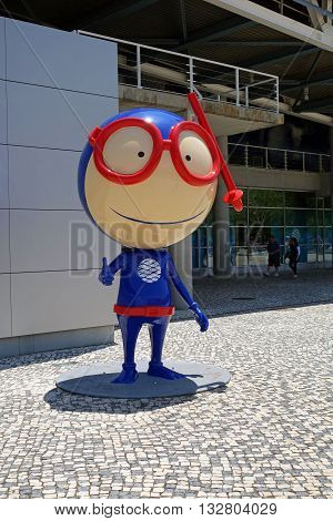 LISBON, PORTUGAL - JUNE 16, 2015: Vasco mascot in front of the facade of the Lisbon Oceanarium modern building, Portugal
