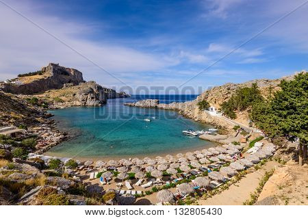 Rhodes island, Greece - May 19, 2016: St. Pauls Bay near Lindos village in May 19, 2016, Rhodes island, Dodecanese, Greece.