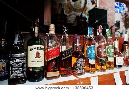 Kyiv, Ukraine - March 25, 2016: Various Alcoholic Beverages Bottles In The Bar.