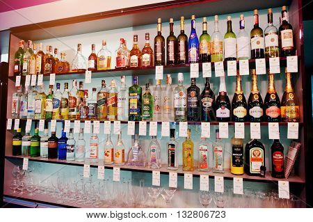 Kyiv, Ukraine - March 25, 2016: Various Alcoholic Beverages Bottles In The Bar On The Shelf.