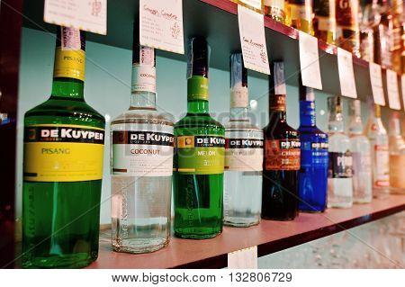 Kyiv, Ukraine - March 25, 2016: Various Alcoholic Beverages Bottles In The Bar. Set Of De Kuyper Liq