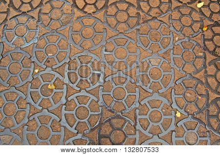 Cast iron pavement on Ancor square in Kronstadt, Russia. The cast-iron pavement on Anchor Square with length of 200 meters