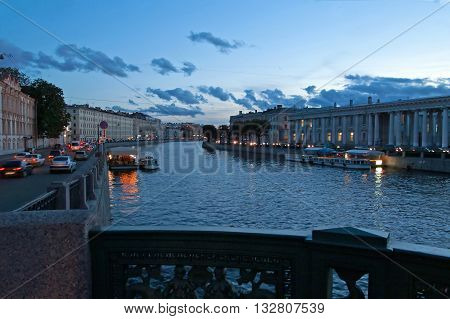 View from Anichkov Bridge in Saint-Petersburg, Russia. The Anichkov Bridge is the oldest and most famous bridge across the Fontanka River in Saint Petersburg Russia. The current bridge built in 1841-42 and reconstructed in 1906-08