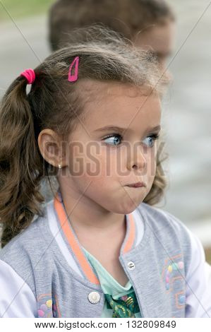 TIMISOARA ROMANIA - JUNE 1 2016: Portrait and expression of one little girl that expected place at one workshop with face painting for children. International children day.