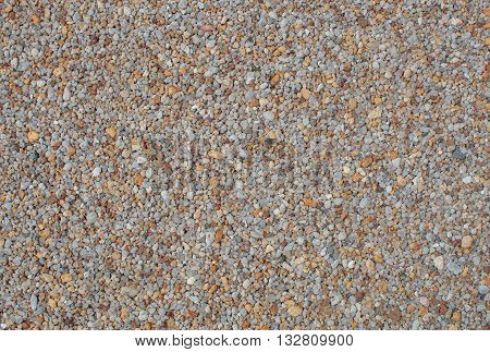 Small colored stones lying on the beach. Texture. Background.