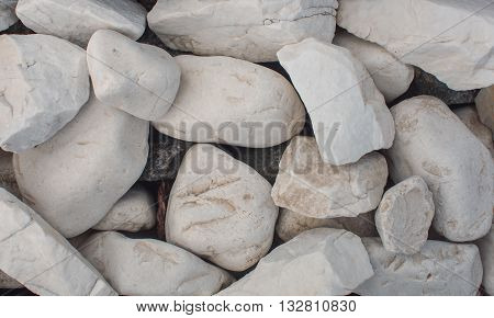 The mound of the big white stones. Texture. Background.