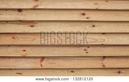 Fence of downed pine boards close-up. Background. Wood texture.