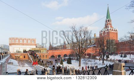 Moscow - January 7 2016: People standing in line to get on the territory of the Kremlin sightseeing and people walk in Aleksandrovskomsad January 7 2016 Moscow Russia