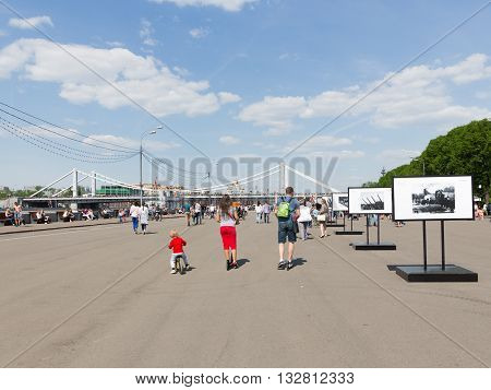 Moscow - May 9 2016: Lots of happy people relax and ride on scooters and bicycles in the summer in Gorky Park May 9 2016 Moscow Russia