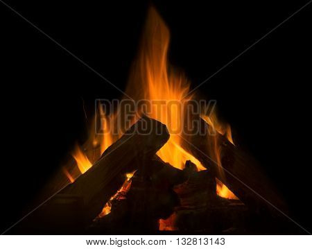 Flame of fire in the fireplace on a black background