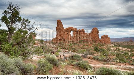 Low-hanging clouds over Turret Arch, in Arches National Park, near Moab, Utah.