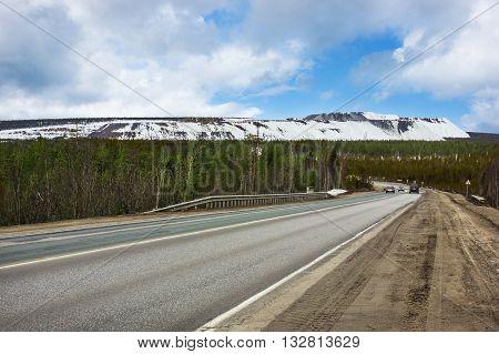 Road Murmansk region Russia. Early spring. April