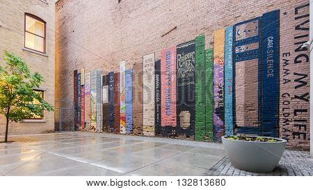 SALT LAKE CITY UT/USA - MAY 15 2016: Mural depicting a bookshelf (book wall) with classics by Kerouac Steinbeck Ginsberg Hesse Huxley Orwell Twain Rowling Baum and Seuss at Eborn Books.
