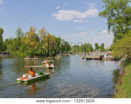 Moscow - May 9 2016: A lot of people have a rest and go for a drive on catamarans in the summer in Gorky Park May 9 2016 Moscow Russia