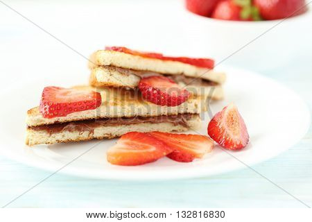French Toasts With Chocolate And Strawberry On Wooden Table